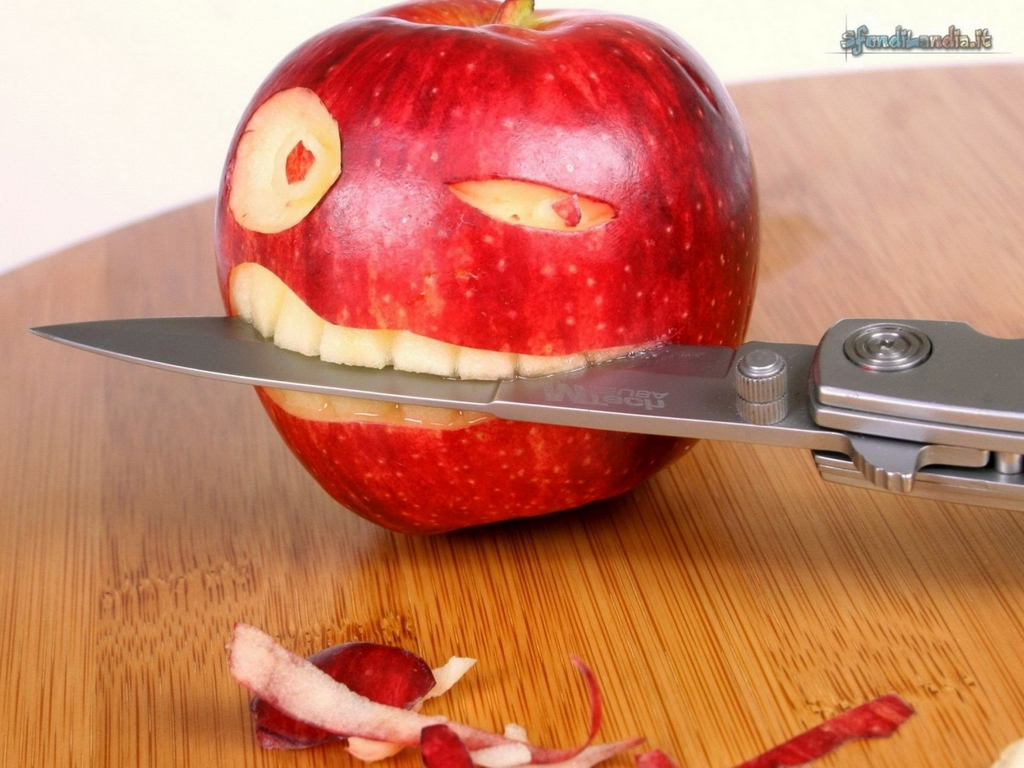 Apple Biting A Knife