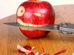 Sfondo: Apple Biting A Knife